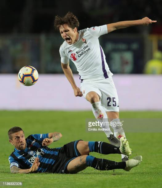 Alejandro Gomez of Atalanta BC competes for the ball with Federico Chiesa of ACF Fiorentina during the TIM Cup match between Atalanta BC and ACF...