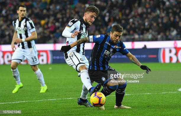 Alejandro Gomez of Atalanta BC competes for the ball with Hidde Ter Avest of Udinese Calcio during the Serie A match between Udinese and Atalanta BC...