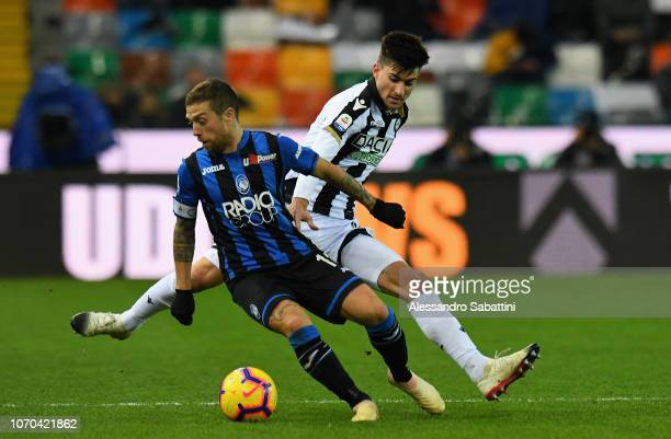 Alejandro Gomez of Atalanta BC competes for the ball with Ignacio Pussetto of Udinese Calcio during the Serie A match between Udinese and Atalanta BC...
