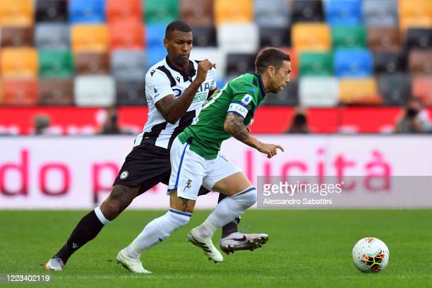 Alejandro Gomez of Atalanta BC competes for the ball with Ken Sema of Udinese Calcio during the Serie A match between Udinese Calcio and Atalanta BC...