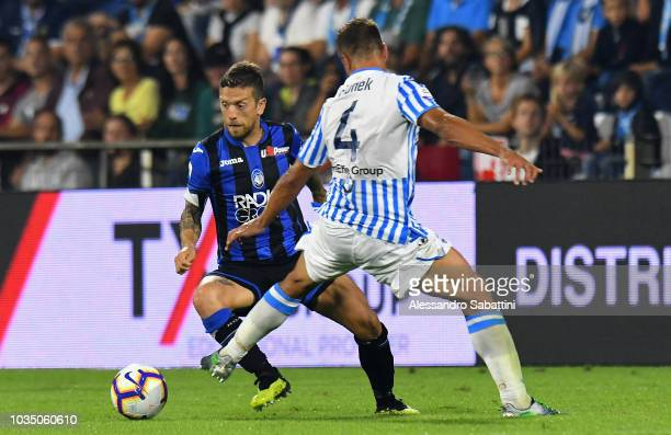 Alejandro Gomez of Atalanta BC competes for the ball with Luca Valzania of Atalanta BC during the serie A match between SPAL and Atalanta BC at...