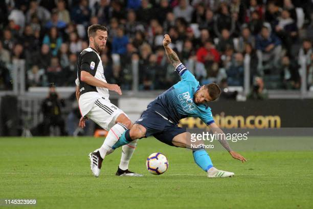 Alejandro Gomez of Atalanta BC competes for the ball with Miralem Pjanic of Juventus FC during the serie A match between Juventus FC and Atalanta BC...