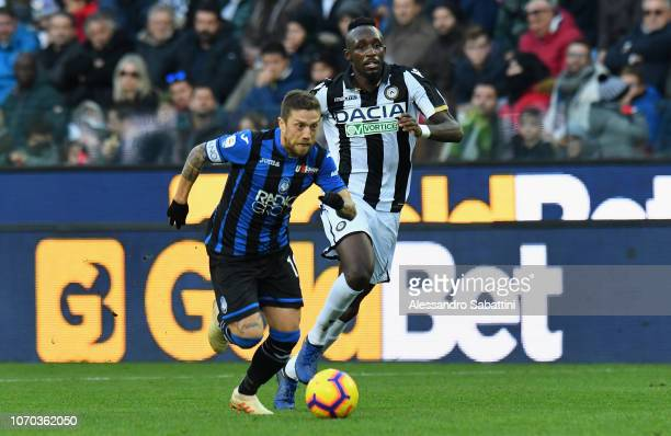 Alejandro Gomez of Atalanta BC competes for the ball with Seko Fofana of Udinese Calcio during the Serie A match between Udinese and Atalanta BC at...