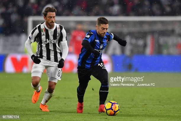 Alejandro Gomez of Atalanta BC in action against Claudio Marchisio of Juventus during the TIM Cup match between Juventus and Atalanta BC at Allianz...