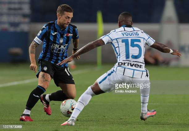 Alejandro Gomez of Atalanta BC is challenged by Ashley Young of FC Internazionale during the Serie A match between Atalanta BC and FC Internazionale...