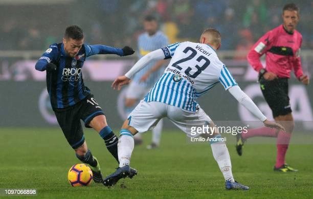 Alejandro Gomez of Atalanta BC is challenged by Francesco Vicari of Spal during the Serie A match between Atalanta BC and SPAL at Stadio Atleti...