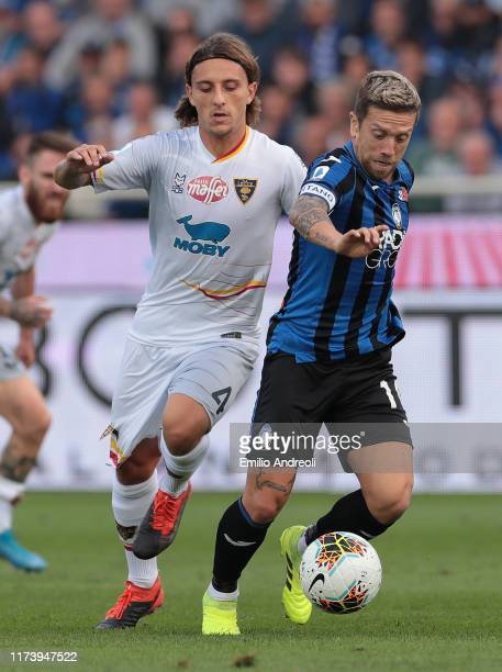 Alejandro Gomez of Atalanta BC is challenged by Jacopo Petriccione of US Lecce during the Serie A match between Atalanta BC and US Lecce at Gewiss...