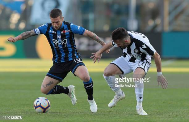 Alejandro Gomez of Atalanta BC is challenged by Marco D Alessandro of Udinese Calcio during the Serie A match between Atalanta BC and Udinese at...