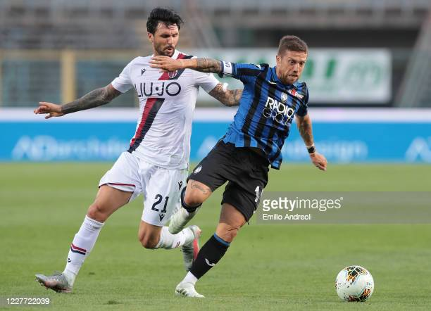 Alejandro Gomez of Atalanta BC is challenged by Roberto Soriano of Bologna FC during the Serie A match between Atalanta BC and Bologna FC at Gewiss...