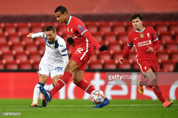 Alejandro Gomez of Atlanta B.C. Is challenged by Joel Matip of Liverpool during the UEFA Champions League Group D stage match between Liverpool FC...