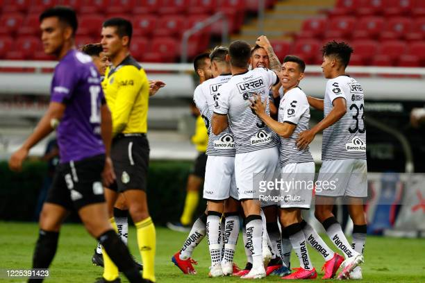 Alejandro Gomez of Atlas celebrates with his teammates after scoring the first goal of his team during the match between Atlas and Mazatlan FC as...