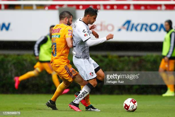 Alejandro Gomez of Atlas fights for the ball with Andrepierre Gignac of Tigres during the match between Atlas and Tigres UANL as part of the...