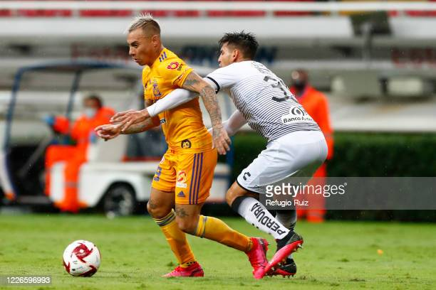 Alejandro Gomez of Atlas fights for the ball with Jesús Dueñas of Tigres during the match between Atlas and Tigres UANL as part of the friendship...