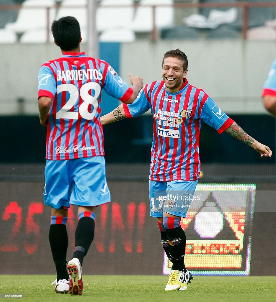 Alejandro Gomez (R) of Catania celebrates after scoring the opening goal during the Serie A match between Calcio Catania and S.S. Lazio at Stadio Angelo Massimino on November 4, 2012 in Catania, Italy.