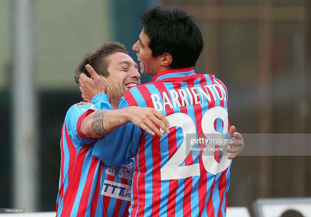 Alejandro Gomez (L) of Catania celebrates the opening goal with his teammate Pablo Barrientos during the Serie A match between Calcio Catania and AS Roma at Stadio Angelo Massimino on January 13, 2013 in Catania, Italy.