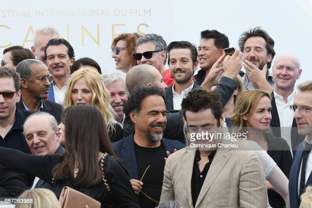 Alejandro Gonzalez Inarritu and Benicio del Toro attend the 70th Anniversary photocall during the 70th annual Cannes Film Festival at Palais des...