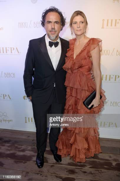 Alejandro Gonzalez Inarritu and María Eladia Hagerman attend the HFPA Participant Media Honour Help Refugees' during the 72nd annual Cannes Film...