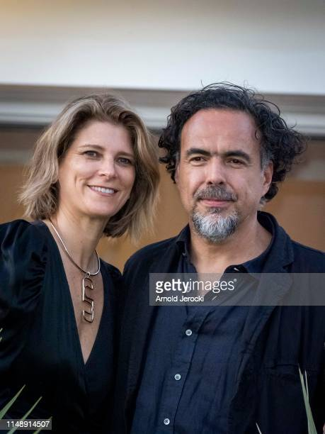 Alejandro Gonzalez Inarritu and Maria Eladia Hagerman arrvies ahead of the 72nd annual Cannes Film Festival at on May 13 2019 in Cannes France