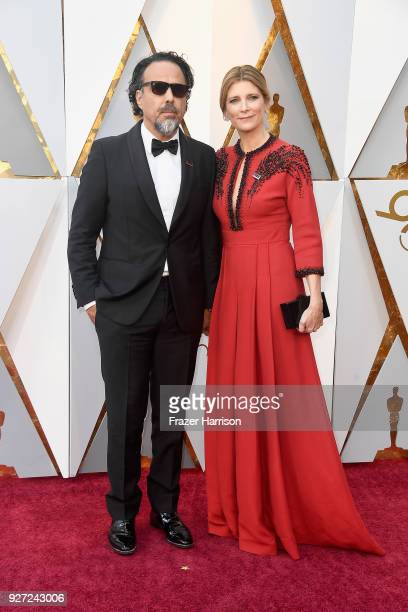 Alejandro Gonzalez Inarritu and Maria Eladia Hagerman attend the 90th Annual Academy Awards at Hollywood Highland Center on March 4 2018 in Hollywood...