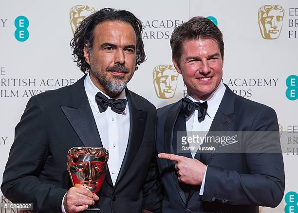 Alejandro Gonzalez Inarritu and Tom Cruise pose in the winners room at the EE British Academy Film Awards at The Royal Opera House on February 14...
