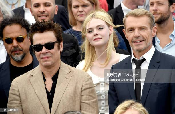 Alejandro Gonzalez Inarritu Benicio del Toro Elle Fanning and Lambert Wilson attends the 70th Anniversary photocall during the 70th annual Cannes...