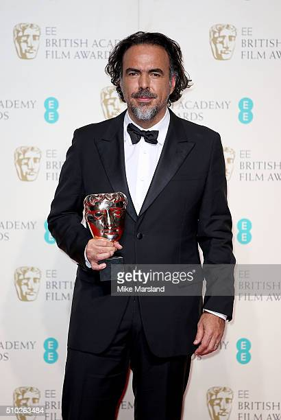 Alejandro Gonzalez Inarritu winner of the Best Director award for 'The Revenant' poses in the winners room at the EE British Academy Film Awards at...