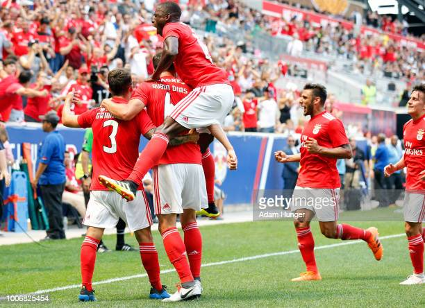 Alejandro Grimaldo of Benfica celebrates scoring a goal with teammates against Juventus during the International Champions Cup 2018 match between...