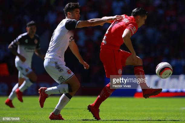Alejandro Guido of Tijuana struggles for the ball with Efrain Velarde of Toluca during the 17th round match between Toluca and Tijuana as part of the...