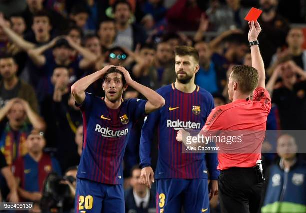 Alejandro Jose Hernandez Hernandez shows a red card to Sergi Roberto of Barcelona as he is sent off during the La Liga match between Barcelona and...