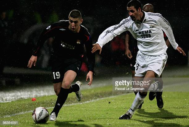 Alejandro Lago of Rosenborg BK is challenged by Karim Benzema of Olympique Lyonnais during the UEFA Champions League football match between Lyon and...