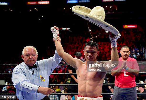 Alejandro Luna has his hand raised by referee Lou Moret after a fourth round TKO over Sergio Lopez of Mexico during a lightweigh bout at Staples...