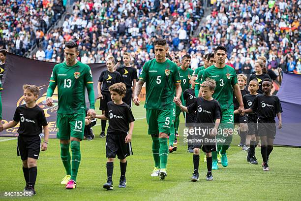 Alejandro Melean Nelson Cabrera and Luis Gutierrez of Bolivia walk on to the field with player escorts before a group D match between Argentina and...
