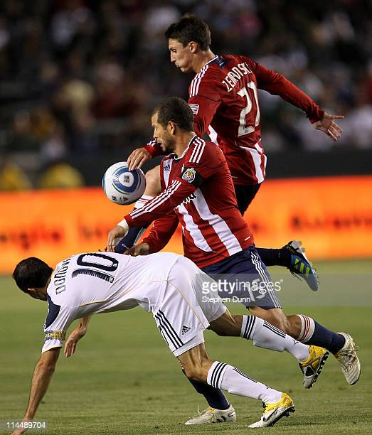 Alejandro Moreno and Ben Zemanski of Chivas USA battle for the ball with Landon Donovan of the Los Angeles Galaxy at The Home Depot Center on May 21...