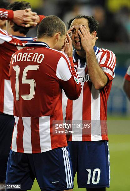 Alejandro Moreno and Nick LaBrocca of Chivas USA celebrate after the game against the Portland Timbers at JeldWen Field on April 7 2012 in Portland...