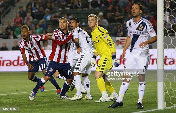 Alejandro Moreno of Chivas USA and AJ DeLaGarza of the Los Angeles Galaxy vie for position in the goalbox prior to a Chivas cornerkick during the MLS...