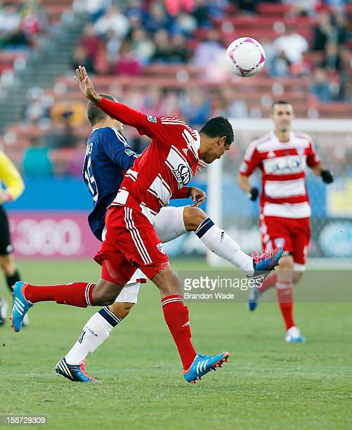 Alejandro Moreno of Chivas USA and Hernan Pertuz of FC Dallas battle for control of the ball during the first half of a soccer game at Pizza Hut Park...