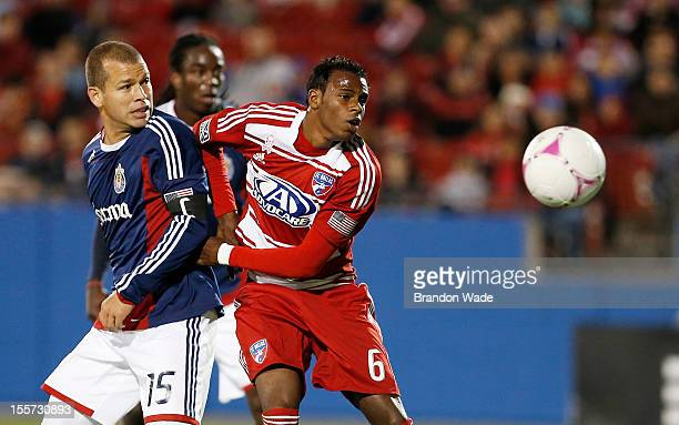 Alejandro Moreno of Chivas USA and Jackson of FC Dallas battle for control of the ball during the second half of a soccer game at Pizza Hut Park on...