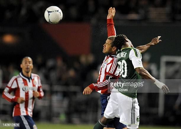 Alejandro Moreno of Chivas USA and Lovel Palmer of the Portland Timbers go up for a ball during the second half of the game at JeldWen Field on April...