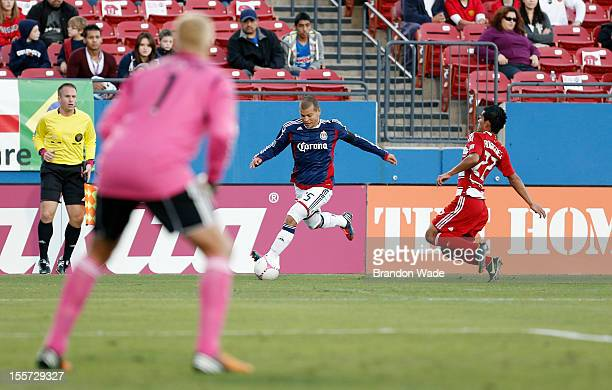 Alejandro Moreno of Chivas USA attempts a shot on goal as goal keeper Kevin Hartman and teammate Carlos Rodriguez of FC Dallas defend during the...