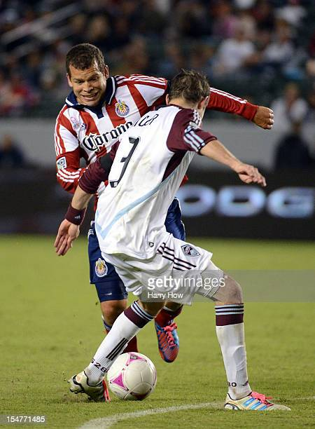 Alejandro Moreno of Chivas USA attempts to dribble around Drew Moor of the Colorado Rapids at The Home Depot Center on October 20 2012 in Carson...