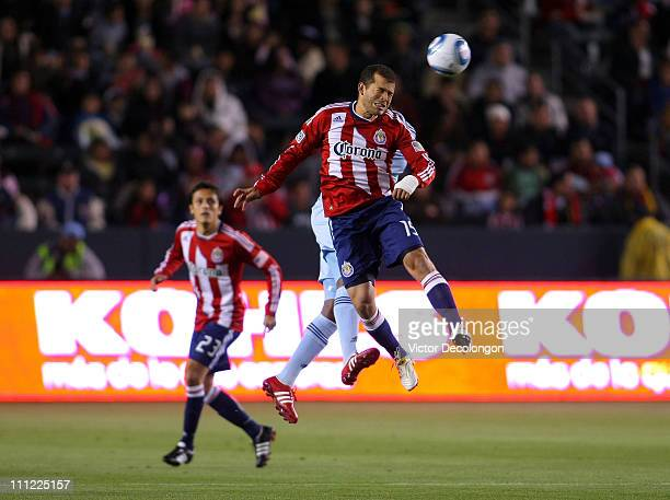 Alejandro Moreno of Chivas USA heads the ball during the MLS match against Sportin Kansas City at The Home Depot Center on March 19 2011 in Carson...