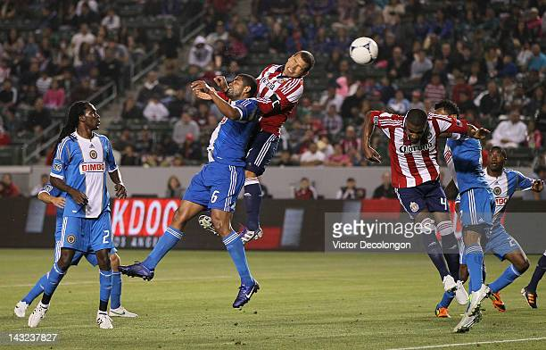 Alejandro Moreno of Chivas USA heads the ball on the corner kick over Gabriel Gomez of Philadelphia Union in the second half during the MLS match at...