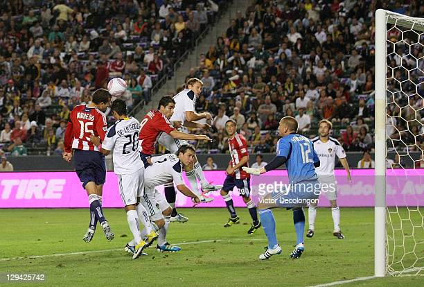 Alejandro Moreno of Chivas USA misses the header from the cornerkick as goalkeeper Josh Saunders of the Los Angeles Galaxy gets in position to defend...