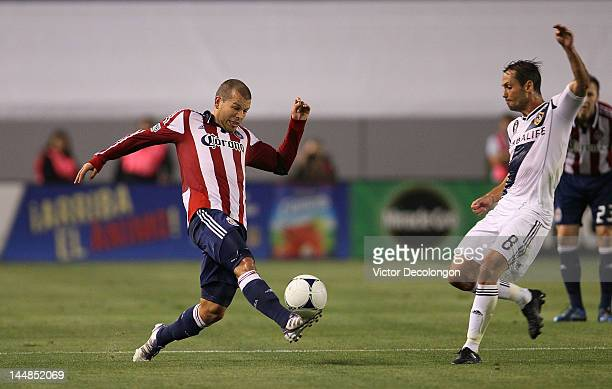 Alejandro Moreno of Chivas USA plays the ball against Marcelo Sarvas of the Los Angeles Galaxy during the MLS match at The Home Depot Center on May...