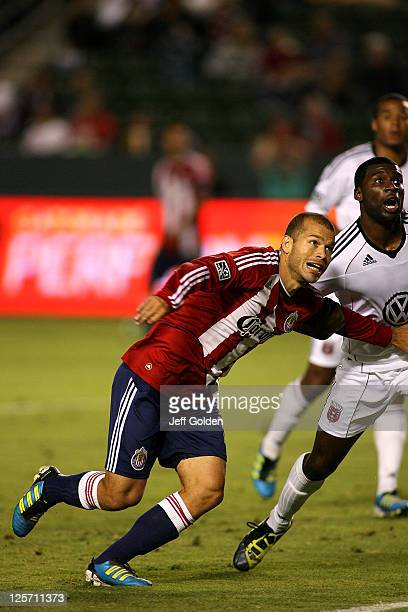 Alejandro Moreno of Chivas USA positions against Brandon McDonald of DC United at The Home Depot Center on September 10 2011 in Carson California