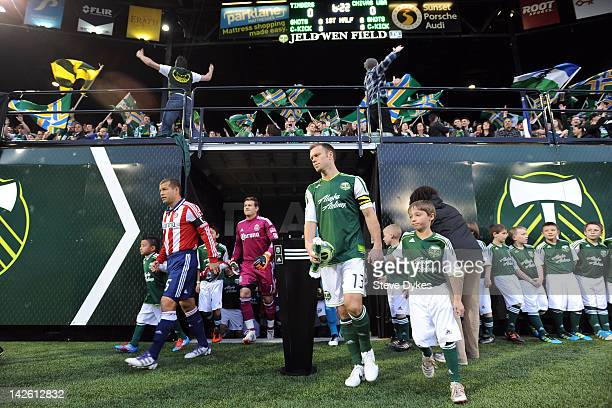 Alejandro Moreno of the Chivas USA and Jack Jewsbury of the Portland Timbers walk out of the locker room before the game between the Portland Timbers...