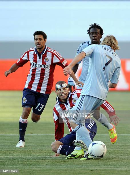 Alejandro Moreno of the Chivas USA attempts to block a pass from Chance Myers of the Sporting KC as Kei Kamara of the Sporting KC and Ante Jazic of...