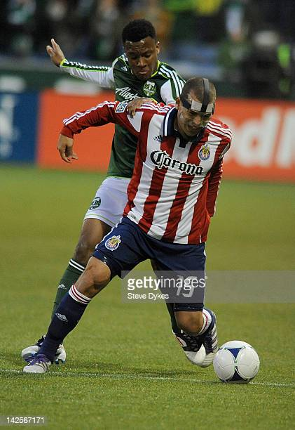 Alejandro Moreno of the Chivas USA battles for the ball with Rodney Wallace of the Portland Timbers during the first half of the game at JeldWen...