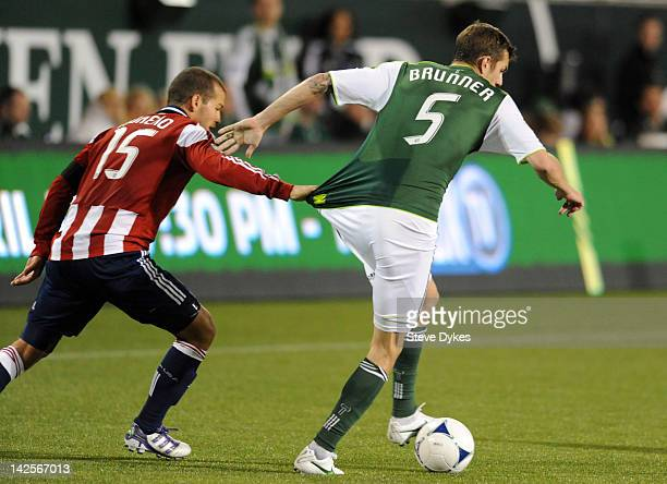 Alejandro Moreno of the Chivas USA grabs a hold of the jersey of Eric Brunner of the Portland Timbers during the second half of the game at JeldWen...