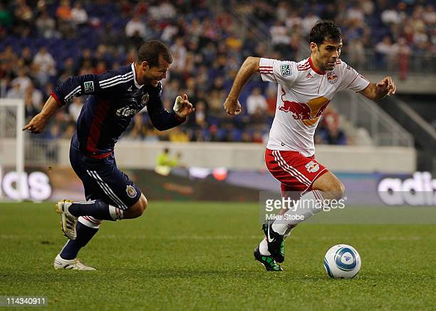 Alejandro Moreno of the Chivas USA pursues Rafa Marquez of the New York Red Bulls on May 15 2011 at Red Bull Arena in Harrison New Jersey Chivas USA...